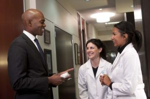 Dr Few, plastic surgeon in Chicago consulting with staff